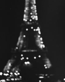 Eiffel Tower at Night View From Street Out Focus, Paris, black & White photo