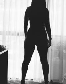 Woman Dark Profile in Window, Black & White Photo