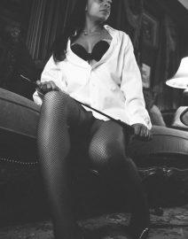 Woman white shirt, black riding crop, Black & White Photo