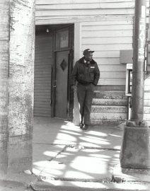Chicago Black Man by door