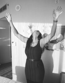 Woman Black Dress Arms to Sky, Black & White Photo