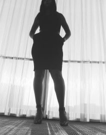 Woman Body Outline in White Window, Black & White Photo