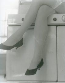 Woman Legs Cross on Stove, Black & White Photo