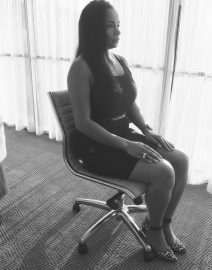 Woman Sitting Office Chair Side View, Black & White Photo