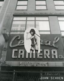 Central Camera Dominatrix, Dominatrix with whip, Chicago black & White Photography, Architectural Photography, hand colored photography